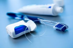 HOW TO LOOK AFTER YOUR DENTAL IMPLANTS-min
